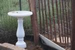 A bird bath from a defunct garden